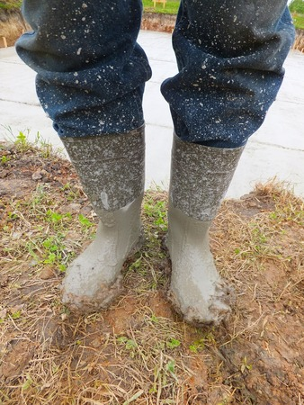 muddy clothes: Rubber boots soiled cement during concreting