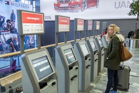 facilitate: OSLO, NORWAY - November 27, 2014: Lots of machines to check passenger hall at Oslo Airport Gardermoen Editorial