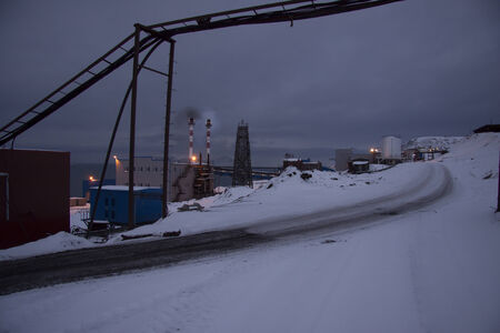 boiler house: View of the Russian mining settlement on Spitsbergen in the far north during the polar night, the view from the top of the boiler house chimney visible