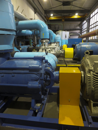 water pump with large electric motors and piping with fittings photo