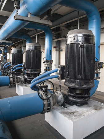 water pump with large electric motors built into an industrial installation photo