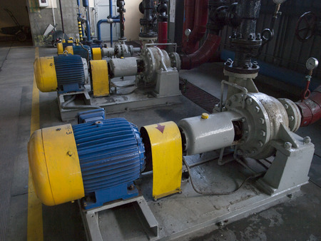 water pump with large electric motors built into an industrial installation Stock Photo