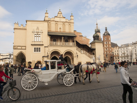 coachman: KRAKOW, POLAND - March 29, 2015: Horse carriage on the streets of the city as a tourist attraction