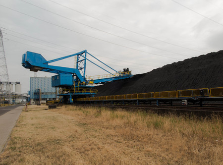 stacker: Stacker with a heap of coal next to the plant