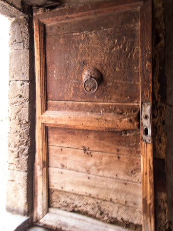sepulchre: old door in the Coptic part of the building of the basilica of the Holy Sepulchre in Jerusalem, Israel Stock Photo