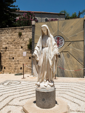 annunciation of mary: statue of Virgin Mary next to the Basilica of the Annunciation in Nazareth, Israel