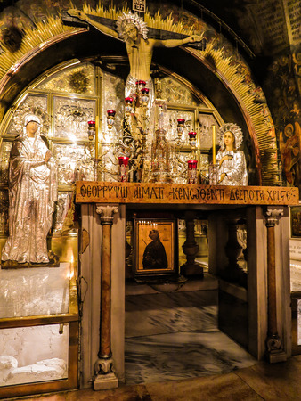 sepulchre: JERUSALEM - Juli 15:  Stone of the Anointing of Jesus in the Holy Sepulchre, the holiest place of Christians, Juli 15, 2015. Jerusalem, Israel Editorial