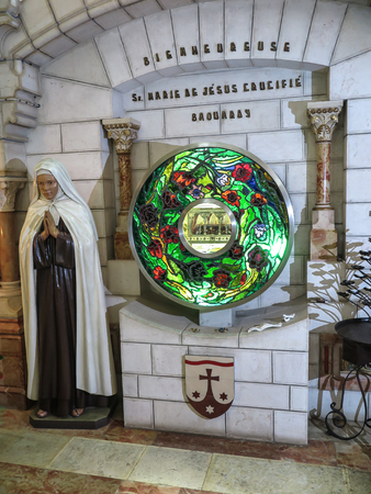 relics: BETHLEHEM, Palestinian Authority, July 12, 2015: Carmelite convent on the Hill of David in Bethlehem view of the interior and the altar, a reliquary with the relics of the holy Baouardy Miriam, Mary of Jesus Crucified, the Little Arab women Editorial