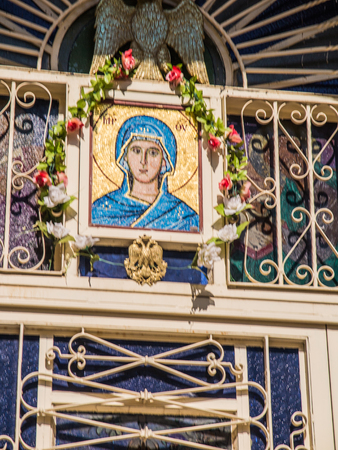 emery: Sychar, Israel, July 11, 2015.: The icon of the Virgin Mary and the dove symbolizing the Holy Spirit over the entrance to the Greek orthodox church in place of the biblical Jacobs well in Sychar in Samaria. Editorial