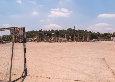 samaria: Sebastia Samaria, ancient Israel, ruins and excavations in the Palestinian territories. Football field and parking in close proximity to the ruins of ancient columns
