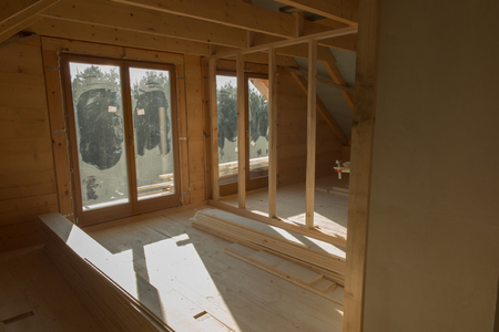 wooden floors: building a house with wooden beams, interior construction of partition walls and floors Stock Photo