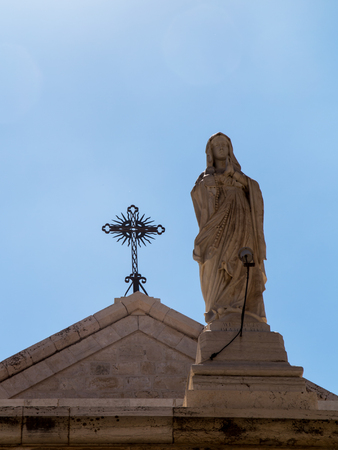 dowry: BETHLEHEM, Israel, July 12, 2015: The city of Bethlehem. Statue of Our Lady before church St. Catherine near the Basilica of the Nativity of the birth of Jesus Christ Editorial
