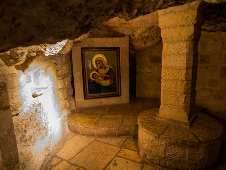 BETHLEHEM, ISRAEL - JULY 12, 2015: Milk Grotto in Bethlehem, Israel. Milk Grotto is a place where they took refuge Holy Family. There is a legend that the food while breast-feeding Jesus with Mary fell on the rock, making it white