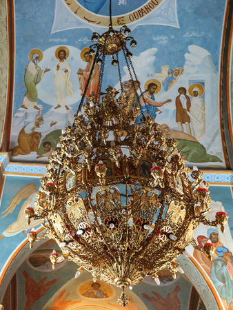 annunciation of mary: Nazareth, Israel, July 8, 2015 .: Ornate chandelier in the orthodox church of the Annunciation of Mary and well in Nazareth