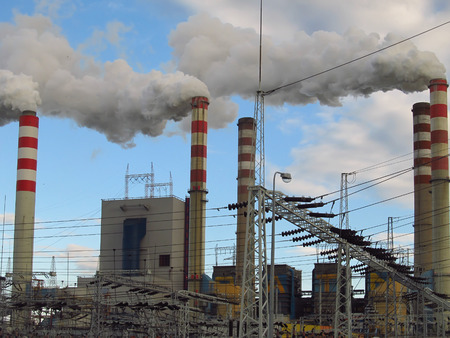 oxides: view chimneys, buildings and infrastructure, lignite-fired power plants, high smoking chimneys