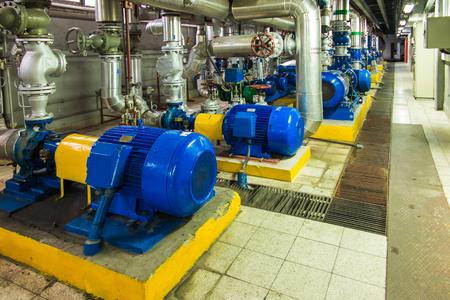 isolation: several water pumps with large electric motors Stock Photo