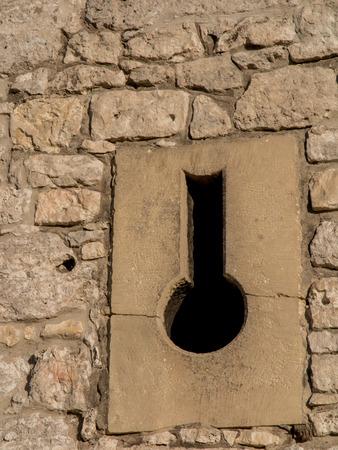 ogrodzieniec: The Ruins of Ogrodzieniec castle - Poland. Fragment of the ruins, the walls of the porthole.