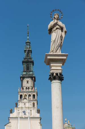 czestochowa: part of the monastery of Jasna Gora in Czestochowa and the statue of Our Lady of the Immaculate Conception in front of the monastery