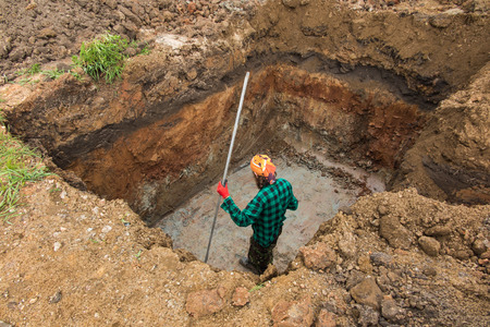 septic tank: digging and leveling the bottom of the backyard septic tank outflow Stock Photo