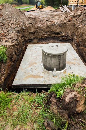 septic tank: insert concrete septic septic tank is dug down Earlier Stock Photo