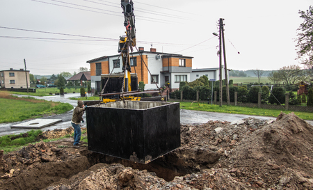 septic tank: insert concrete septic septic tank to earlier dug down Stock Photo