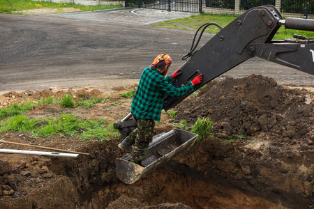 digging and leveling the bottom of the backyard septic tank outflow Stock Photo