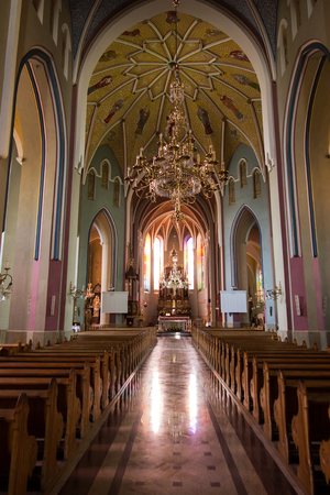 Sokolow Malopolski, Poland - June 9, 2016: The interior of the shrine, the Church of St. John Baptist in Sokolow Malopolski in Poland with the image of Mary in the crowns of the Shrine of Our Lady Queen of the World - Nursing Human Roads