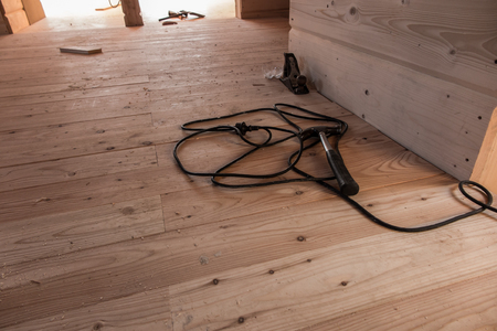 cable cutter: a fragment of a wooden house under construction and tools Stock Photo