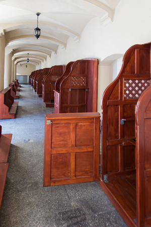 arrepentimiento: Mount St. Anna, Poland - July 4, 2016: Empty confessionals, a place of repentance and conversion. International Shrine of St. Anne, Mount St. Anna, Poland