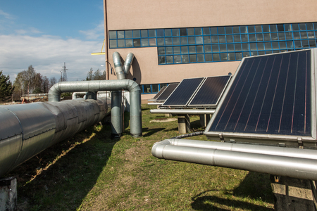 solar heating: solar collectors supporting the work of heating Stock Photo