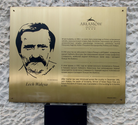 laureate: Arlamow, Poland - July 18, 2016: A plaque on the wall commemorating the internment of the building at this point, in 1982, Lech Walesa first president of the trade union Solidarnosc, the future Nobel Peace Prize laureate and President Polish