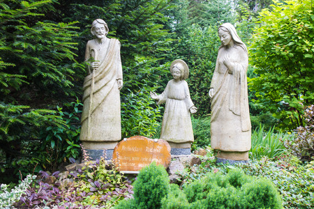 interned: Komancza, Poland - July 20, 2016: Figures of the holy family in the area near to the convent of the Sisters of Nazareth in Komańcza. From 1955 to 1956, in the monastery was interned Cardinal Stefan Wyszynski
