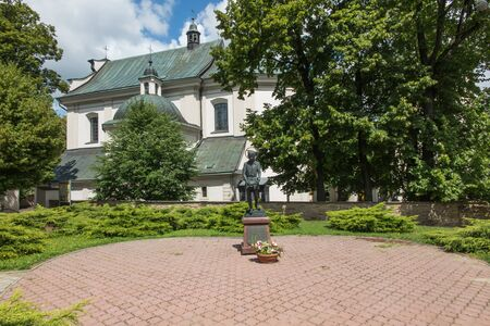 st john: Dukla, Poland - July 20, 2016:  St. John of Dukla of bread in front of the parish church in Dukla, Poland Editorial