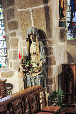 mount saint michael: Mont Saint Michel, France - September 8, 2016: The interior of the church of St. Peter in the Mont Saint-Michel in Normandy with old statue of Mary, France.