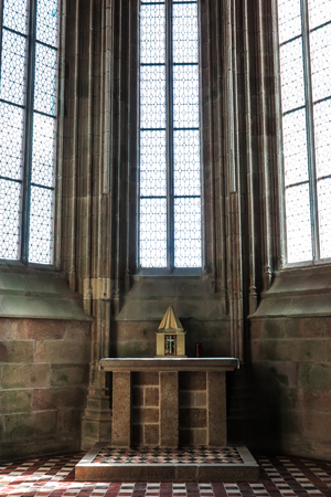 tabernacle: Mont Saint Michel, France - September 8, 2016, Benedictine Abbey of Mont Saint-Michel in Normandy, France. A modest stone altar Editorial