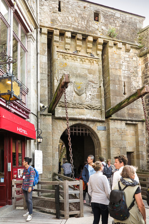 strengthening: Mont Saint Michel, France - September 8, 2016: Unidentified tourists in the commercial part of the Mont Saint Michel, France Editorial