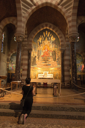 Paray Le Monial, France - September 13, 2016:  Shrine of St. Claude de la Colombiere in Paray-le-Monial, France, mosaic behind the altar inside the church