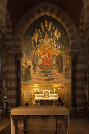 confessor: Paray Le Monial, France - September 13, 2016:  Shrine of St. Claude de la Colombiere in Paray-le-Monial, France, mosaic behind the altar inside the church