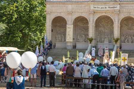 Pontchateau, France - September 11, 2016: Celebration of 300 anniversary of the death of St. Louis Monfort, Monfort jubilee year. In the picture, Jean-Paul James, Bishop of Nantes and Father General Santino Brembilla SMM and unidentified participants of t Editorial