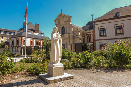 Statue of St. Therese of the Child Jesus on the square in front of the chapel of the Carmel Lisieux in France