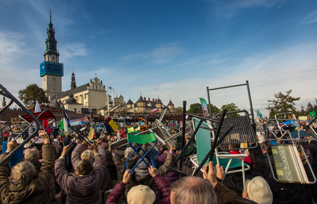 vigil: Czestochowa, Poland - October 15, 2016: United Atonement, all-day prayer meeting people from all over Polish, who repented of his sins and his compatriots before the top Jasna Gora. Tender: Leave the comfortable chairs and go ...! Editorial
