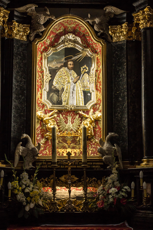 red cross red bird: Krakow, Poland - October 2, 2016 r. Altar of St. Stanislaus of the first Polish saint in the Church of the Pauline Fathers on Skalka Krakow with the pectoral cross of Pope John Paul II
