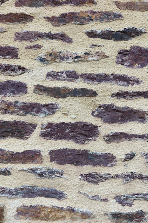 irregular shapes: Fragment of a wall of stone with irregular shapes and broad joints as a background Stock Photo