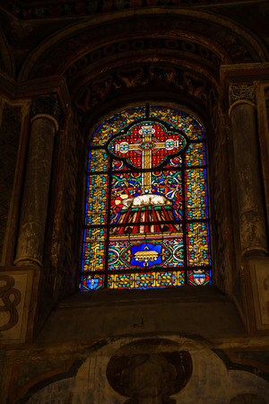 lamb of god: Poitiers, France - September 12, 2016: Colorful stained glass window in the Church of St. Radegund at Poitiers in France Editorial