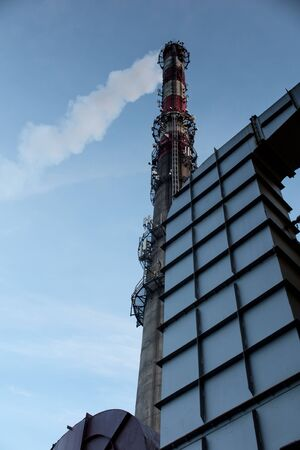 escorted: Tall stack of concrete with built additional antennas of mobile telephony