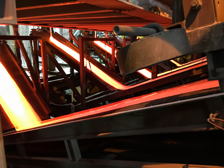 glasswork: production of enamel, the streams of molten glass at the installation
