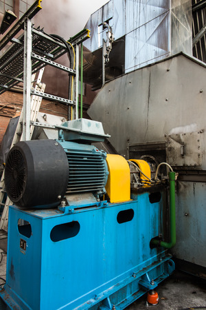 electric motor: large electric motor used to drive the fan exhaust