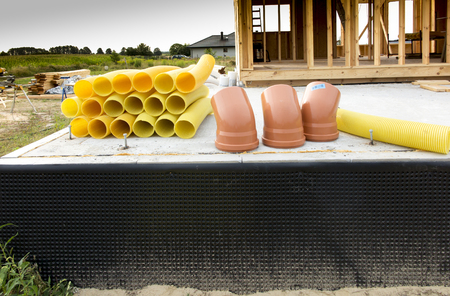 gasket: Pipes with cutouts prepared for the construction of a ground heat exchanger Stock Photo