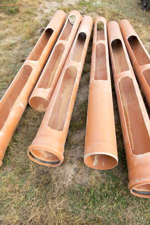 Pipes with cutouts prepared for the construction of a ground heat exchanger Stock Photo