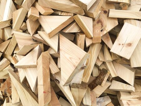piece of woods, incurred during construction of the house in technologi skeletal, lying on the stack as the background Stock Photo